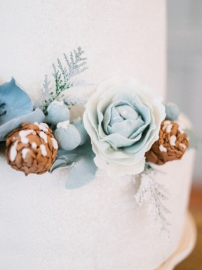 Wedding cake decorated with blue flowers and pine cones | Light Blue Winter Wedding Read more Real Winter Weddings | fabmood.com #winterwedding