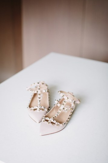 A pair of Valentino Rockstud T-Bar flats | fabmood.com #vanlentino #flatbridalshoe #studflatshoes #weddingshoesflat