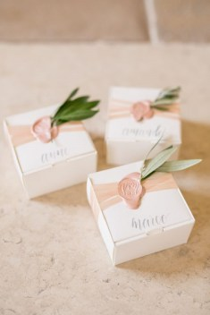 Blush wax seal on wedding favor
