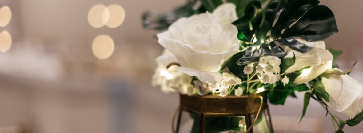 Terrarium centrepiece embellished with roses and greenery Accessory Hire | Fabulous Functions UK | Swindon