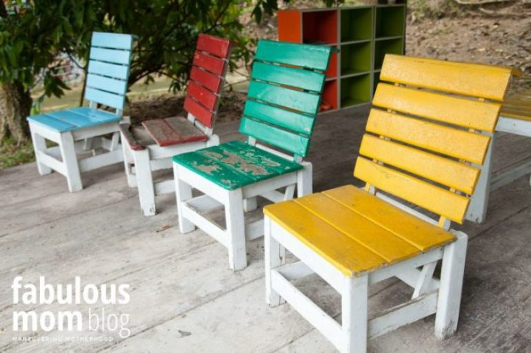Colorful wooden chairs. Located on a small wooden chair.