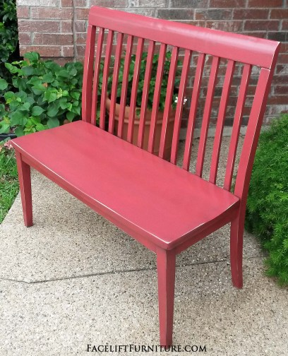 Bench in distressed Barn Red, with Black Glaze providing an antiqued look. From Facelift Furniture's DIY Blog.