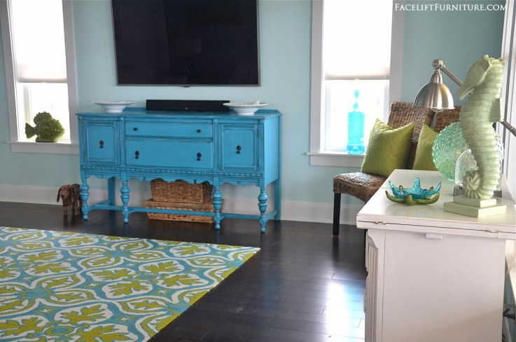 Chunky buffet in in distressed aqua with black glaze. From the Beach House collection at Facelift Furniture.