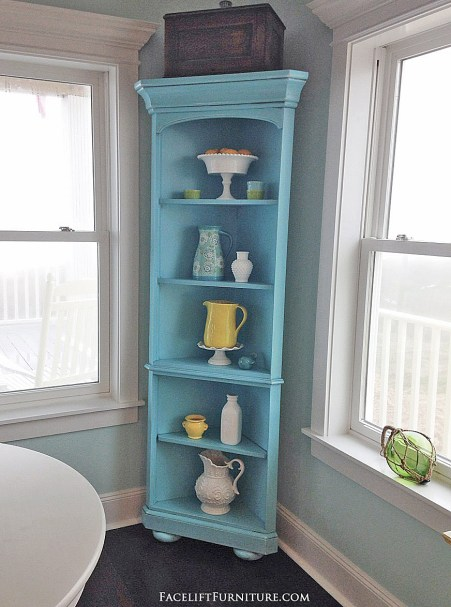 Corner shelf makeover in distressed blue with black glaze. From the Beach House collection at Facelift Furniture.