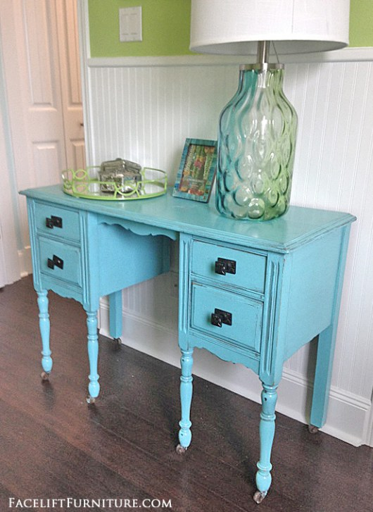 Vanity desk makeover in distressed blue with black glaze. From the Beach House collection at Facelift Furniture.