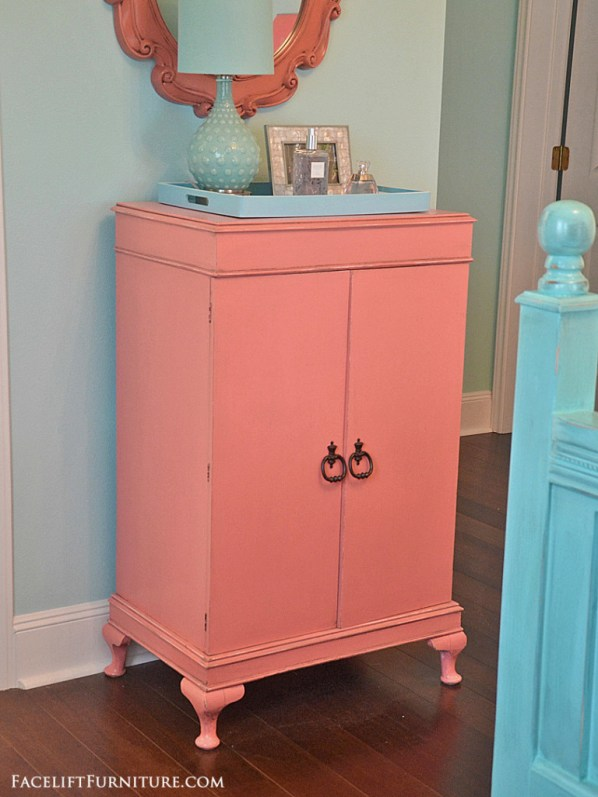 Cabinet makeover in distressed coral with black glaze. From the Beach House collection at Facelift Furniture.