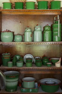 A variety of green toned heritage tableware on display shelves at The Bangala Hotel in Chettinad, Tamil Nadu.