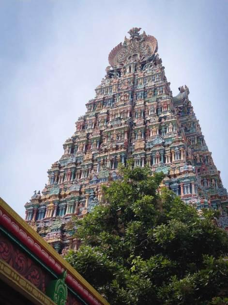 The Meenakshi Amman Temple soars upward into a blue sky, Madurai, Tamil Nadu.