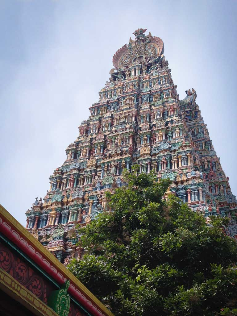 The Meenakshi Amman Temple soars upward into a blue sky, Madurai, Tamil Nadu.