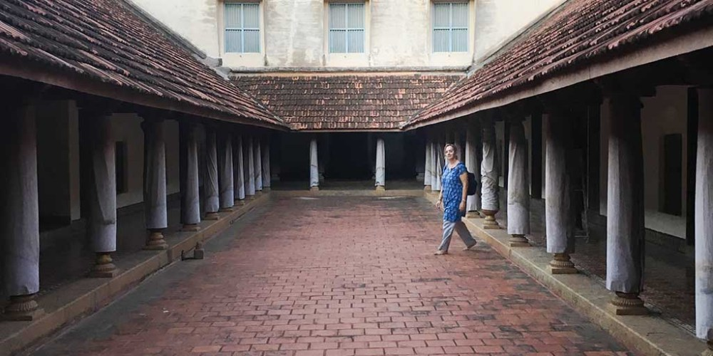 Karen enters the inner courtyard of a Chettiar mansion.
