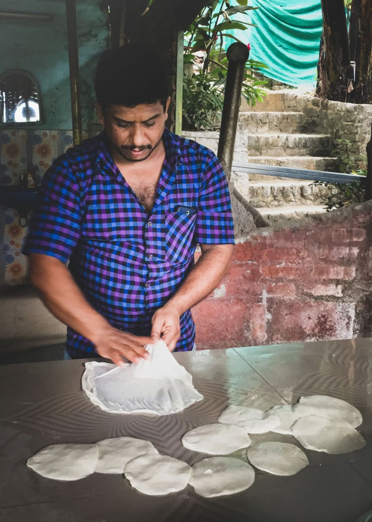 Sheril in the kitchen of his Thekkady cooking school preparing paratha.