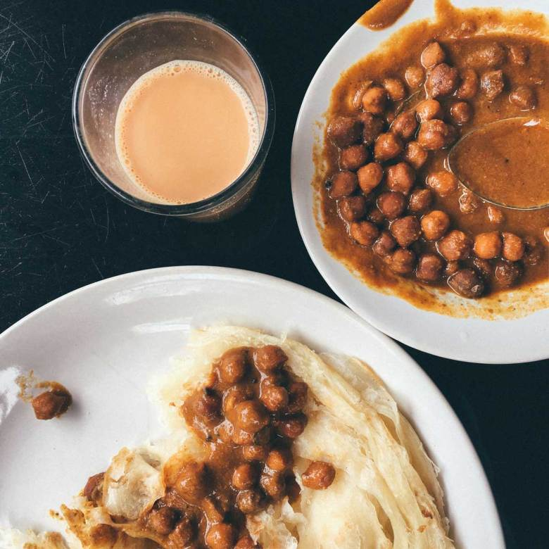 Kadala curry, flaky paratha, and creamy cardamom-scented chai