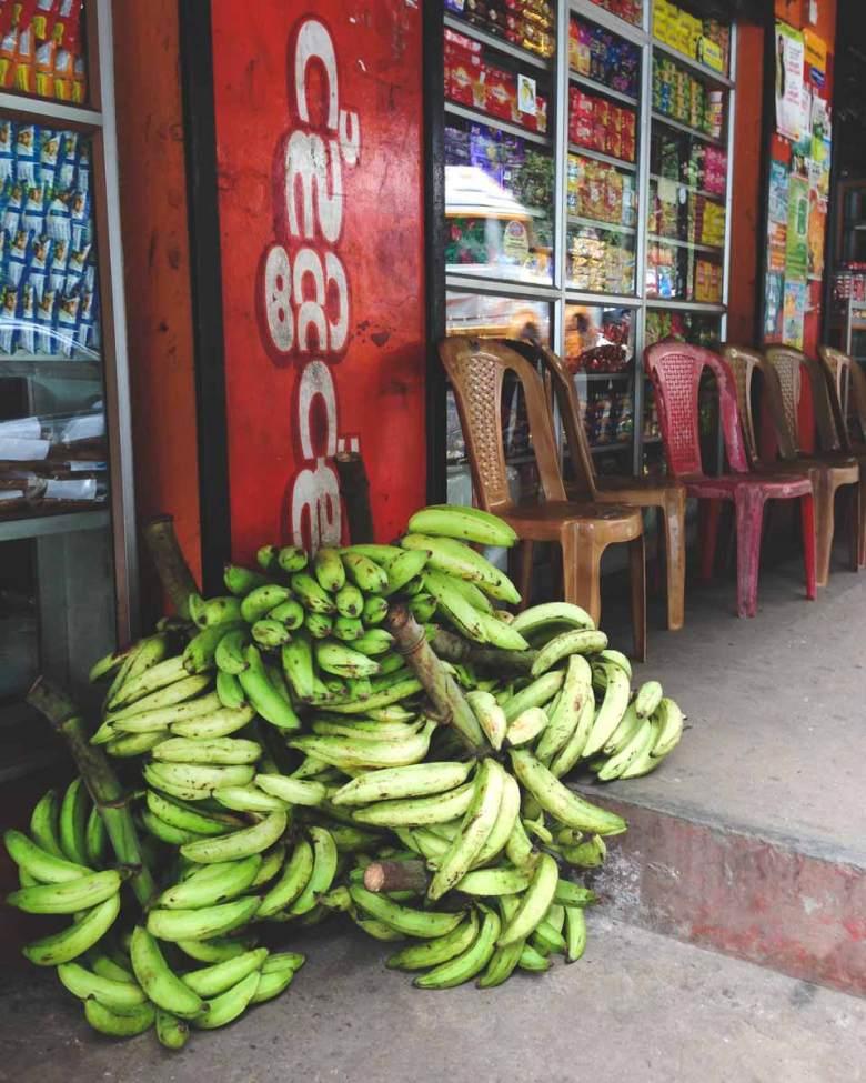 banana bunches at a store front