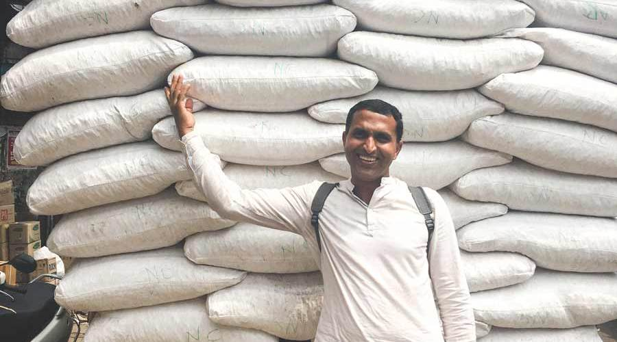 Supply truck filled with white sacks in Big Bazar Street Kozhikode
