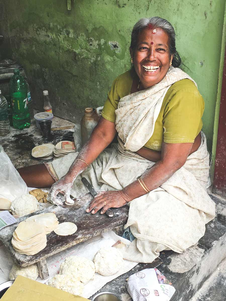 Papadam maker smiling