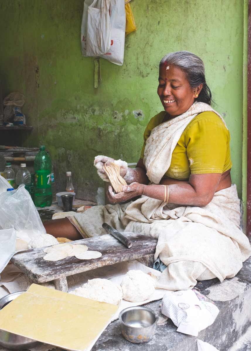 Papadam maker holding dough