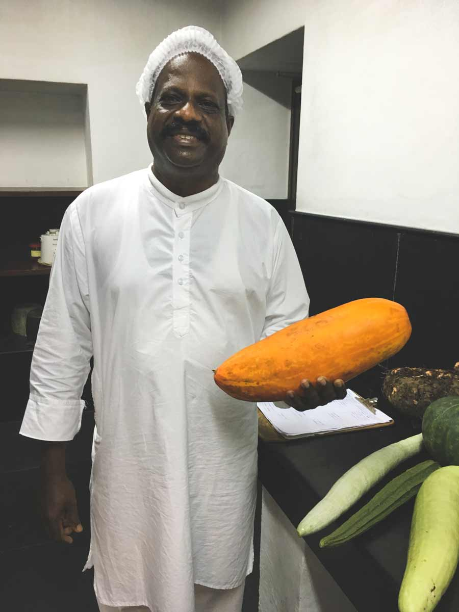 Chef with large orange gourd
