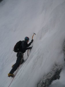 Placing an ice screw on the Largarde Coulior with Spindrift Avalanches enveloping me