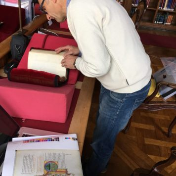 Giacomo analyzing the manuscript