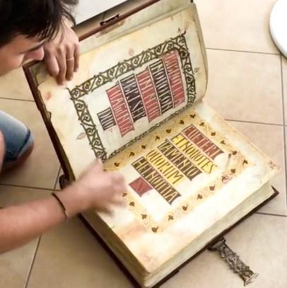 Giovanni leafing through the Visigothic-Mozarabic Bible