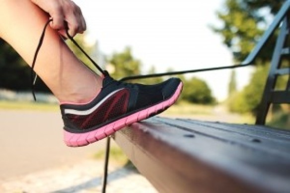 1-woman-tying-sports-shoe-on-bench