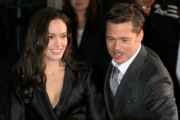 TOKYO, JAPAN - JANUARY 29: Actress Angelina Jolie (L) and Actor Brad Pitt (R) greet fans during 'The Curious Case of Benjamin Button' Japan Premiere at Roppongi Hills on January 29, 2009 in Tokyo, Japan. The film will open in Japan on Feburary 7. (Photo by Kiyoshi Ota/Getty Images)