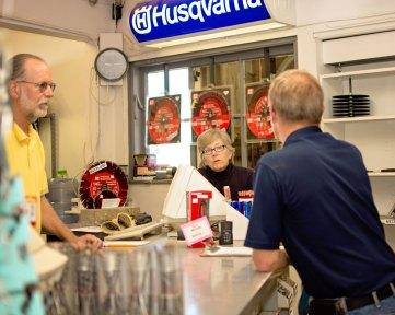 Reid and Regan serving a customer