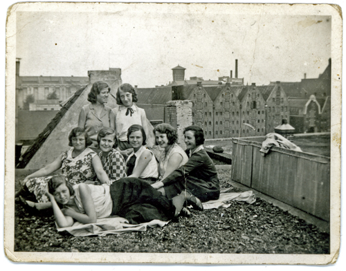 My grandmother as a young woman with colleagues taking a break up on the roof in Amsterdam circa 1920s