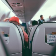 Flight - airline passenger seat with flight attendant in the background