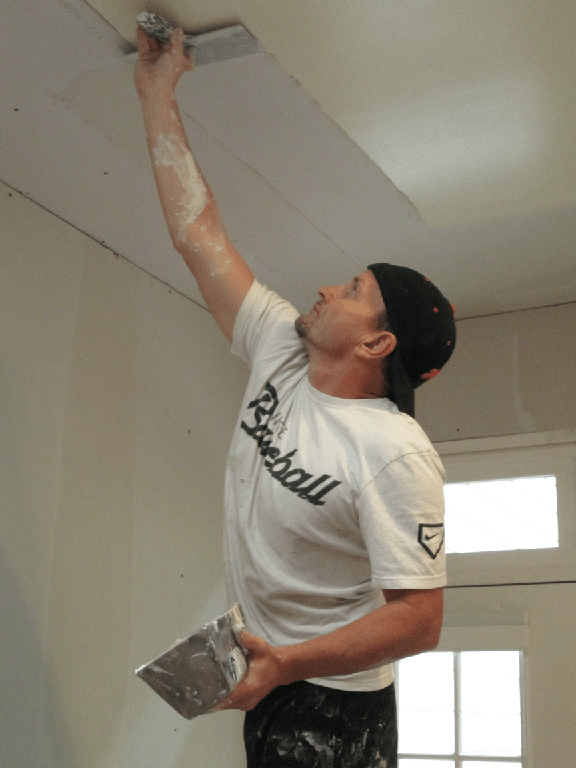 Mike Faircloth mudding a complex drywall angle