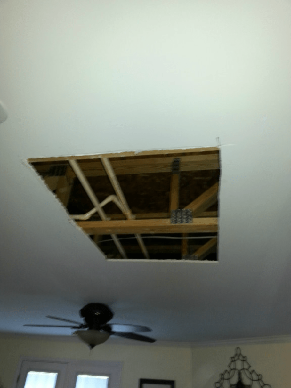 drywall ceiling with large hole cut in it