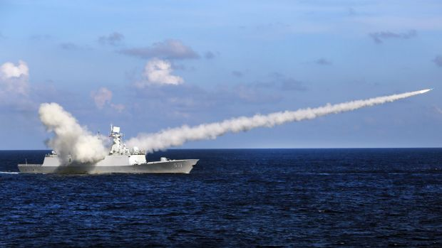 The Chinese missile frigate Yuncheng launches an anti-ship missile during a military exercise in the waters near south ...