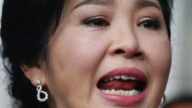 Former Thailand's Prime Minister Yingluck Shinawatra talks to reporters on the last day of a hearing in Bangkok Thailand.
