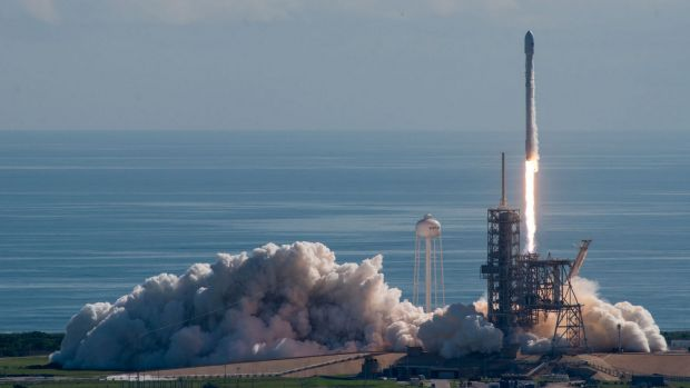 A SpaceX Falcon 9 rocket lifts off with the Pentagon's test vehicle attached.