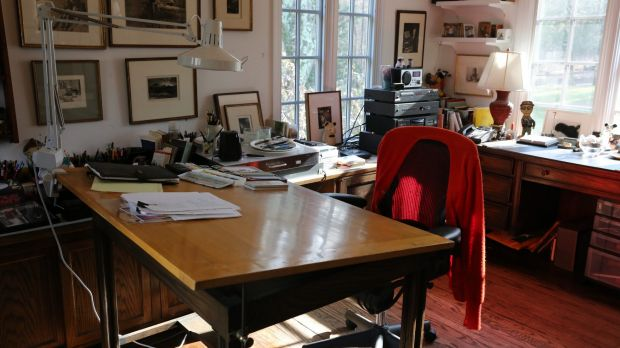 Maurice Sendak's red cardigan still hangs over his chair.