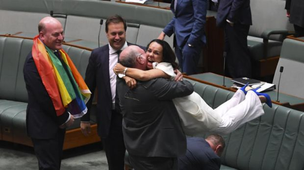 Liberal MP Warren Entsch hugs Labor MP Linda Burney as they celebrate the passing of the Marriage Amendment Bill in the ...