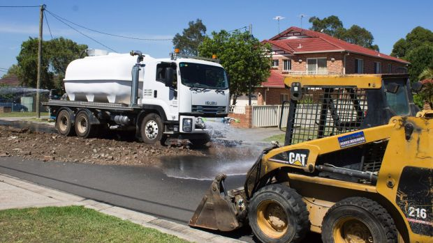 The City of Canterbury Bankstown workers removing waste that was illegally dumped in Chester Hill overnight.