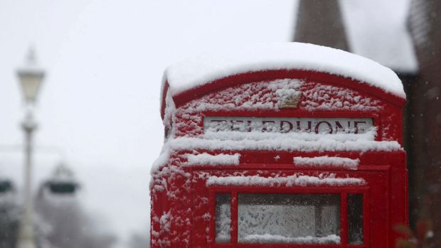 A snow covered phone box in Marlow, England, after heavy snow fell across parts of the UK.
