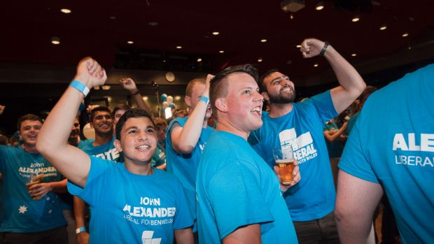 Jubilant Liberal supporters wait for Prime Minister Malcolm Turnbull to speak.