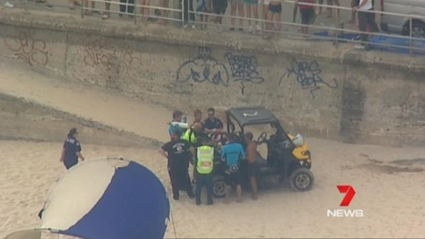 Paramedics and lifeguards treated the man before he was taken to an ambulance.