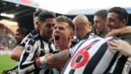 Newcastle United's Matt Ritchie, center, celebrates with teammates after scoring his side's first goal of the game ...
