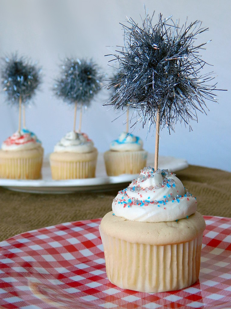 "Vanilla Cupcakes with Strawberry Filling and ""Sparkler"" Toppers"