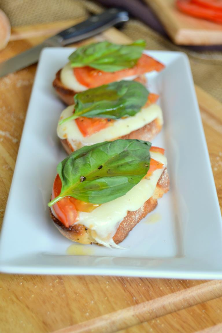 Roasted Caprese Salad on Baguette Slices with Red Wine Vinaigrette