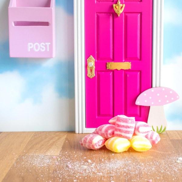 bright pink fairy door with toadstool