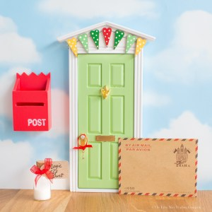 green magic elf door with bunting, uk