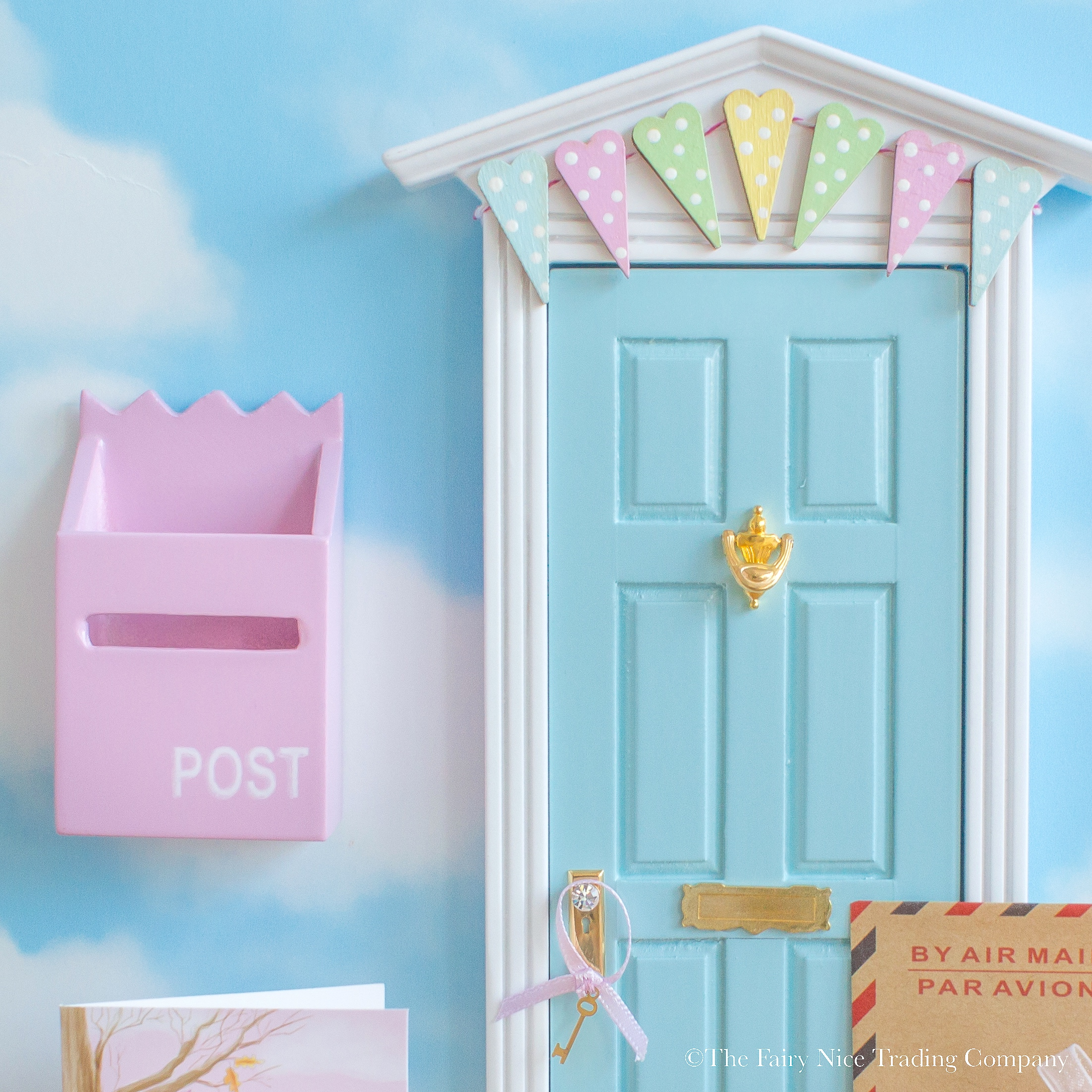 Beautiful blue fairy door with bunting the fairy nice for Fairy door with fairy