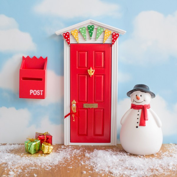 Red Christmas Fairy Door with bunting, UK