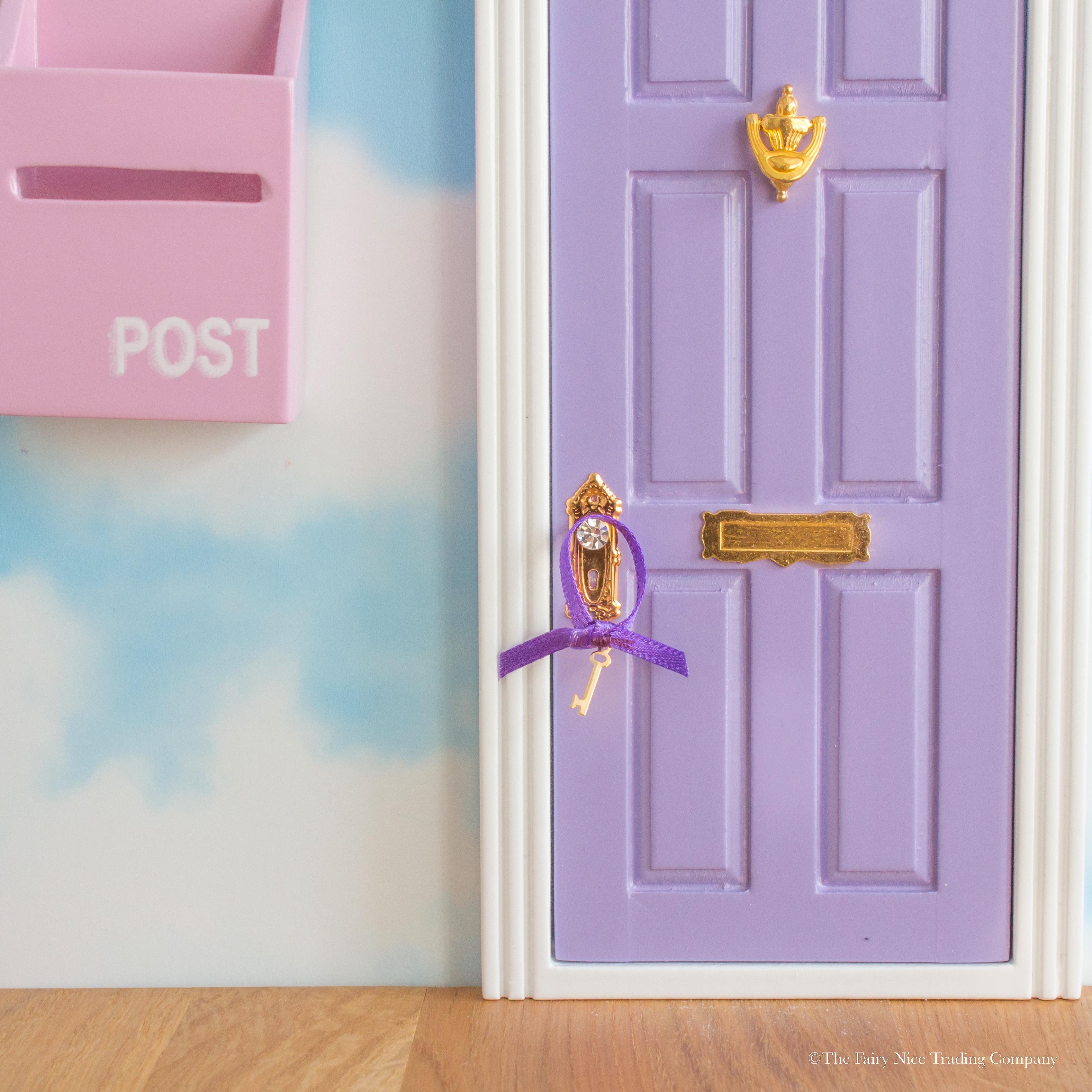 Pretty purple fairy door with bunting the fairy nice for Fairy door with fairy