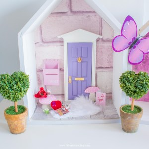 purple fairy door with toadstool