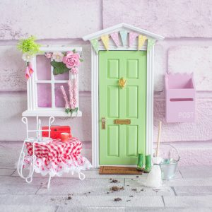 green fairy door with bunting